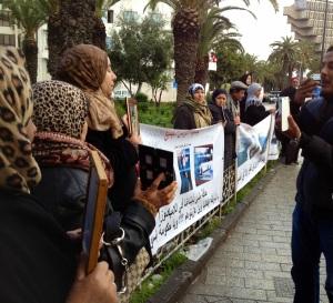 2 photo women w banner